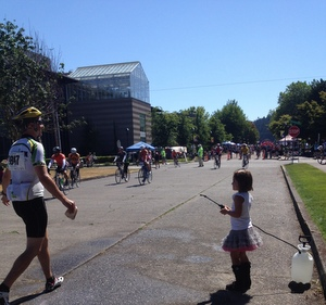 Little girl sprays STP riders to cool them off