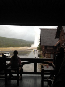 Watching Old Faithful erupt. Old Faithful Inn, Yellowstone National Park