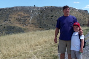 David and Josh with the Buffalo Jump in the background.