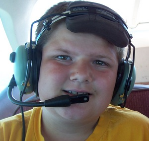 Josh happy to be in the plane, but not happy he's not sitting in the front seat.