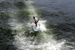 Paddlboarder riding the wake, Columbia Gorge Sternwheeler